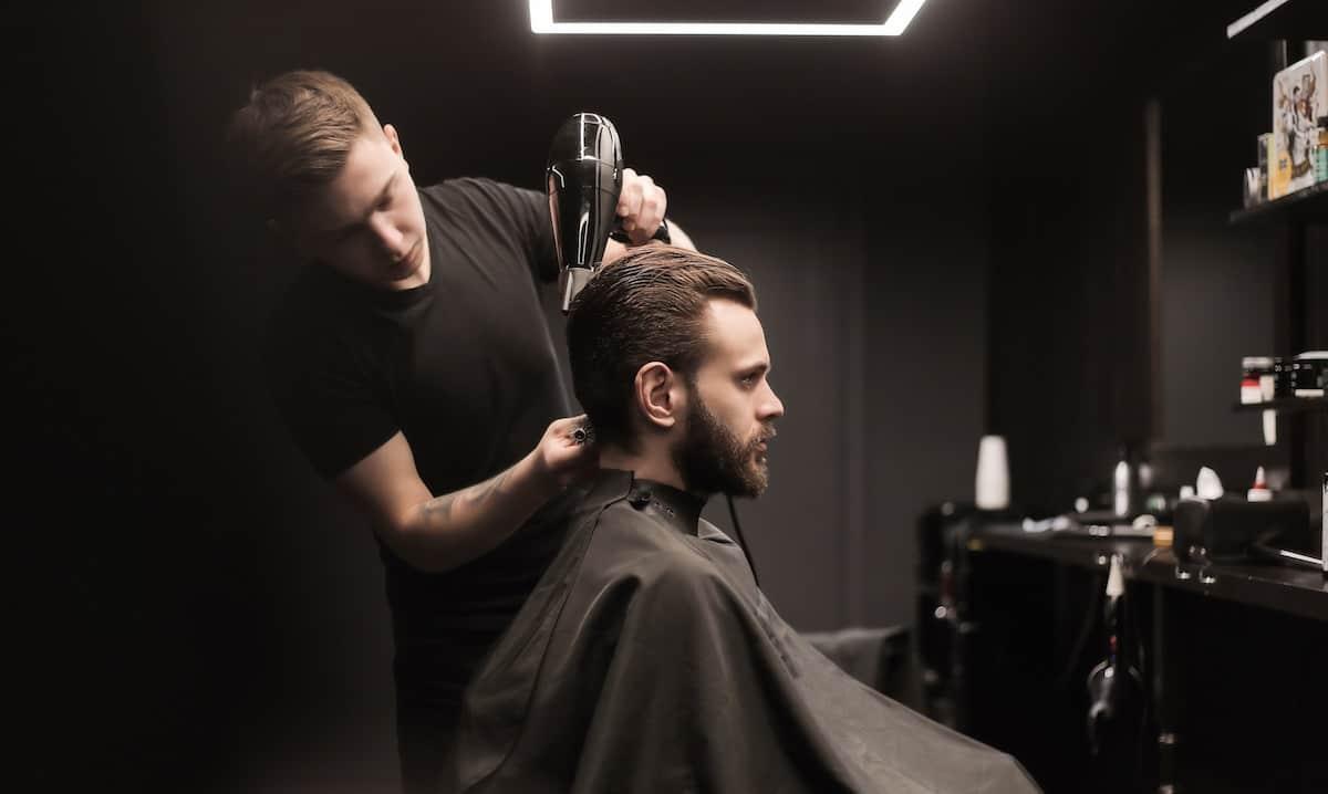 barber drying customer hair